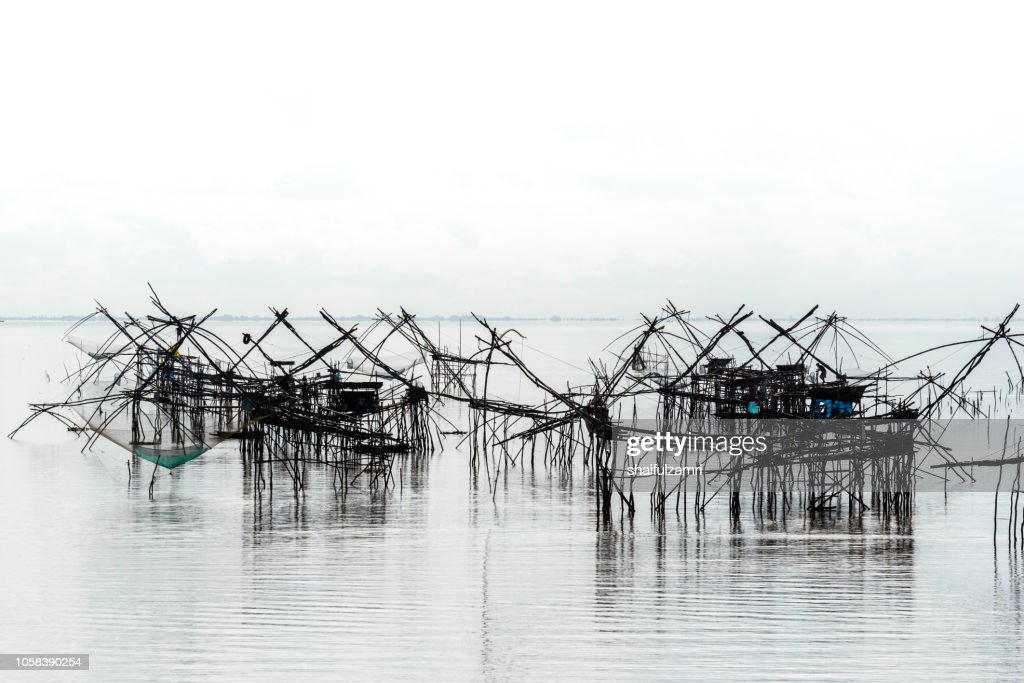 Traditional fishing nets over cloudy day at Phatthalung, Thailand. : Stock Photo