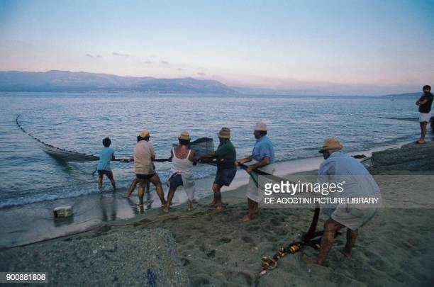 Traditional fishing with the sciabica net Sicily Italy
