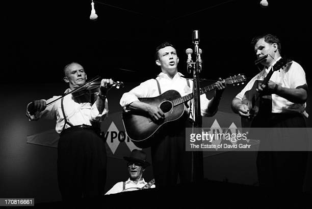 Traditional folk and oldtimey musicians including fiddler Fred Price banjoist musician and singer Clarence Ashley guitarist and singer Clint Howard...