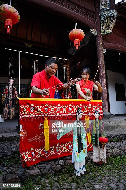 traditional folk artists were playing puppet drama in quzhou, zhejiang, china. - puppet show stock photos and pictures