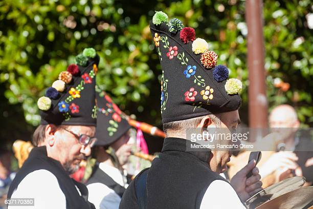 Traditional folk musicians wearing multuicolored embroidered hats