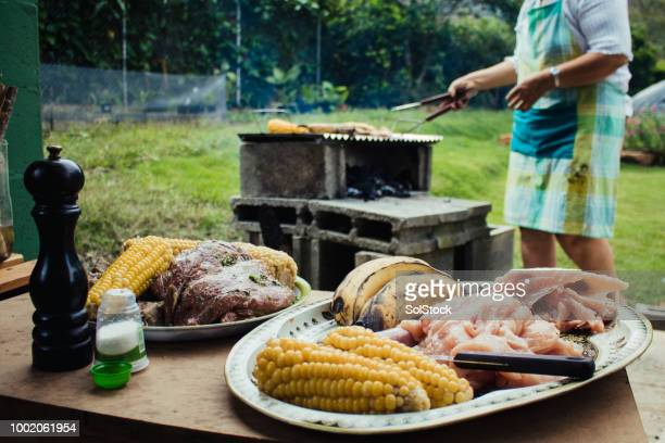 traditional food for latin american bbq outdoors - cali colombia stock pictures, royalty-free photos & images