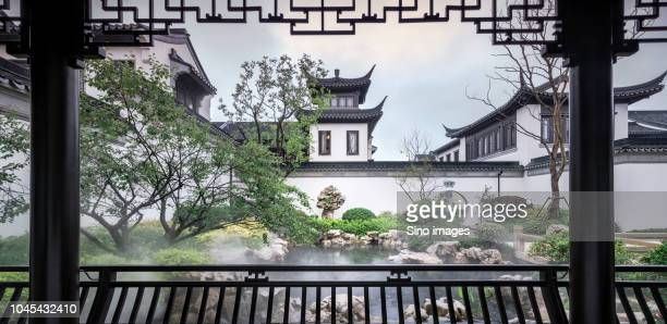traditional garden and buildings in suzhou, jiangsu, china - image stockfoto's en -beelden