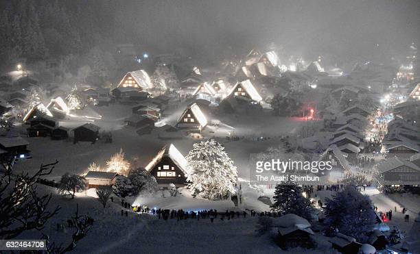 Traditional 'gasshozukuri' thatched farm houses are snowcovered and illuminated on January 22 2017 in Shirakawa Gifu Japan The popular sightseeing...