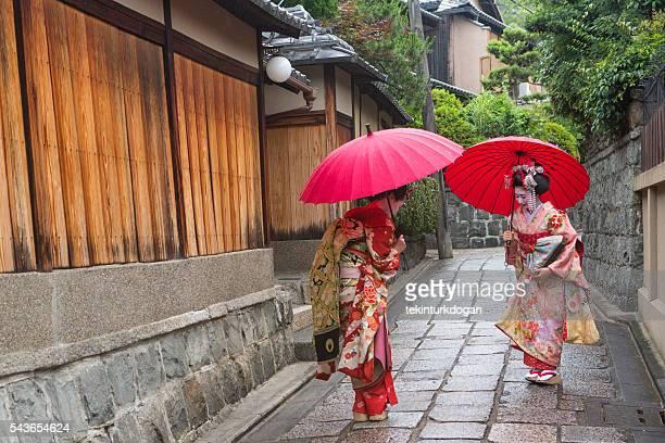 traditional geisha maiko girls  at street of kyoto japan