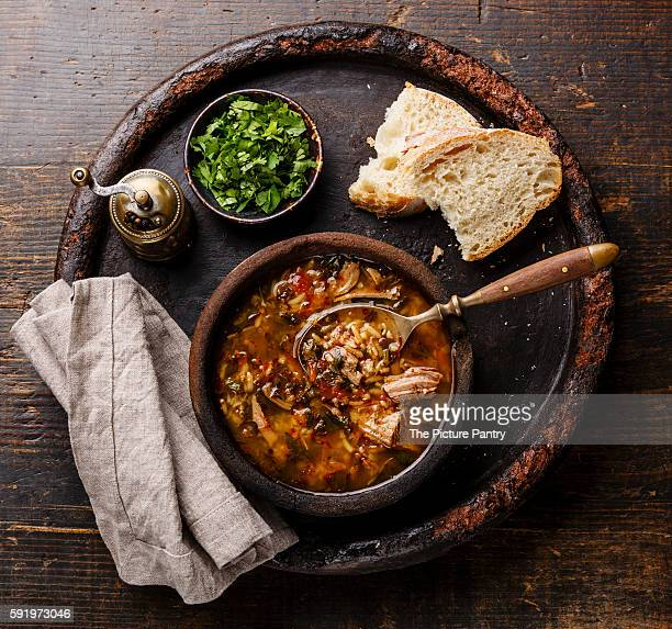 Traditional Georgian soup Kharcho with meat and rice on wooden background