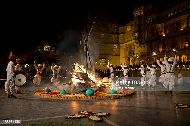 Traditional Ger dancers and musicians at The Maharana's City Palace for annual Hindu Holi Fire Festival by The Zenana Mahal Udaipur Rajasthan India
