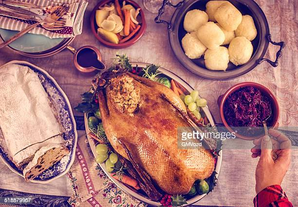 Traditional German Holiday Goose Dinner with Dumplings and Red Cabbage