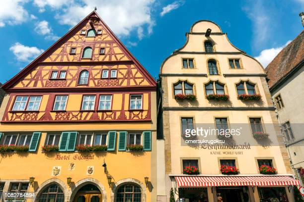 Traditional German houses with Sardinia flowers in Rothenburg ob der Tauber, Bavaria, Germany.