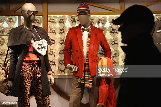 A traditional German Lebkuchen cookie with the words 'Merry Christmas' is seen hanging on a mannequin in the display window of a department store as...