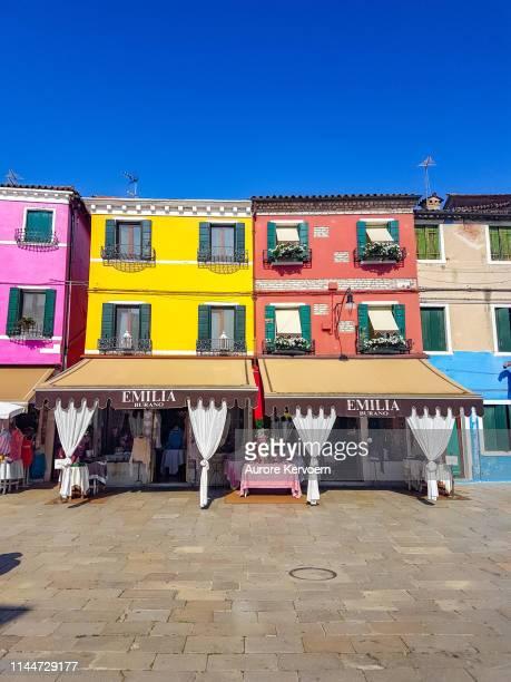 traditional gift shops of burano, italy - burano foto e immagini stock