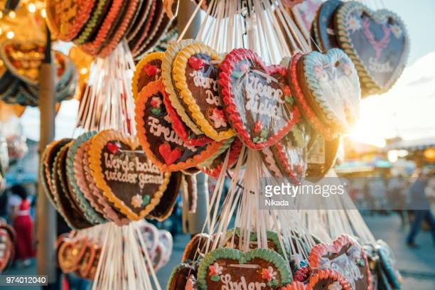 traditional gingerbread hearts at the oktoberfest, munich, germany - oktoberfest stock pictures, royalty-free photos & images