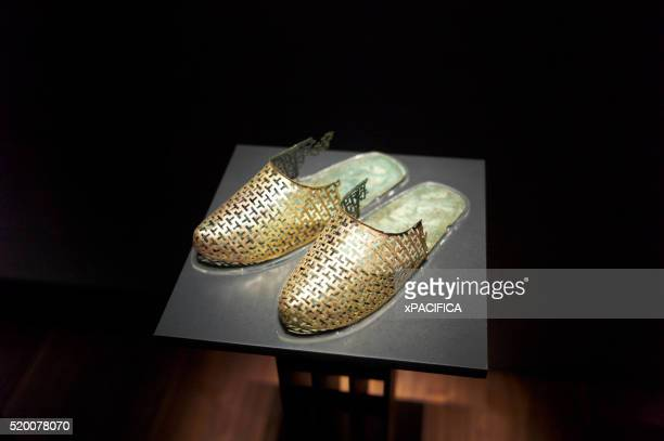 Traditional gold ceremonial footwear on display at the Leeum Samsung Museum of Art, Seoul, South Korea
