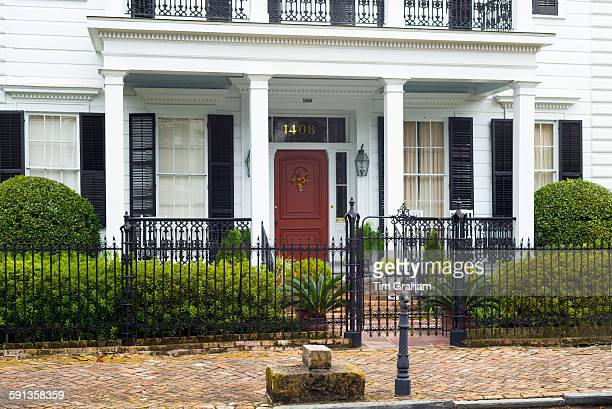 Traditional grand mansion house with columns and porch in the Garden District of New Orleans Louisiana USA