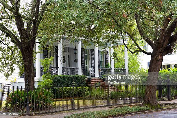 Traditional grand mansion house with columns in the Garden District of New Orleans Louisiana United States of America