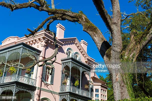 Traditional grand mansion house with lacy ironwork fretwork in the Garden District of New Orleans Louisiana USA