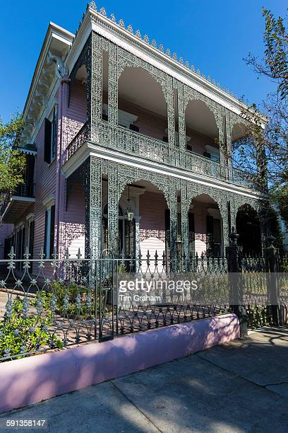 Traditional grand mansion house with ornate wrought iron in the Garden District of New Orleans Louisiana USA