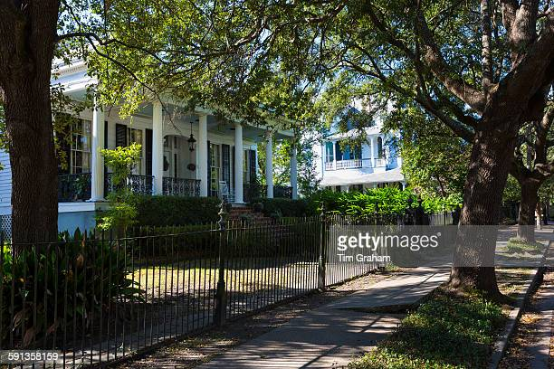 Traditional grand mansion house with wrought iron in the Garden District of New Orleans Louisiana USA