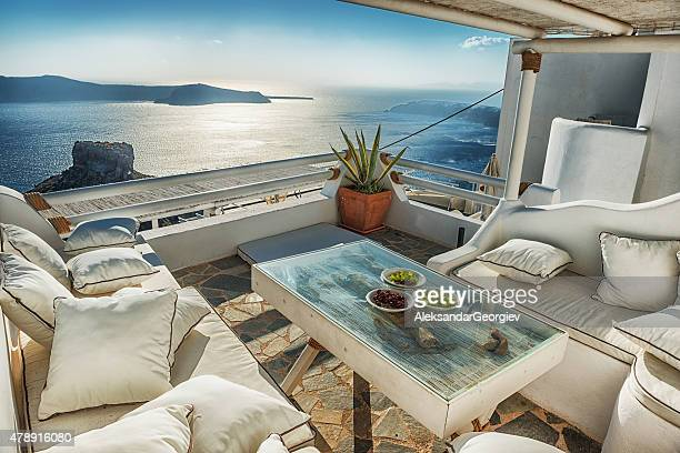 traditional greek cafeteria with view of volcano and santorini caldera - oia santorini stock pictures, royalty-free photos & images