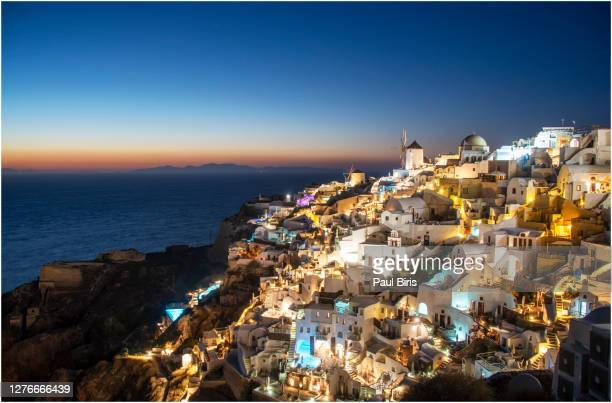 traditional greek village oia (ia) on santorini island in dusk - greek orthodoxy stock pictures, royalty-free photos & images