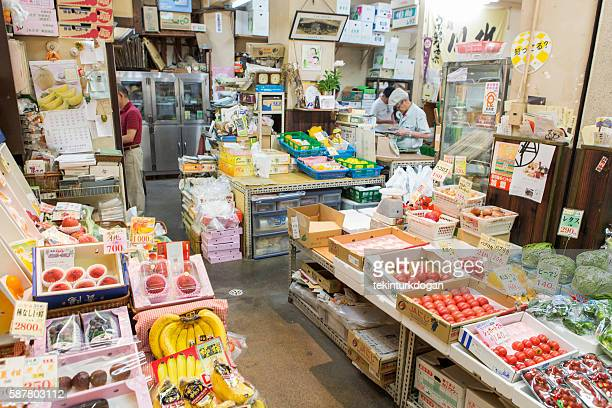 traditional grocery shop at nishiki fishmarket in kyoto japan - nishiki market stock photos and pictures
