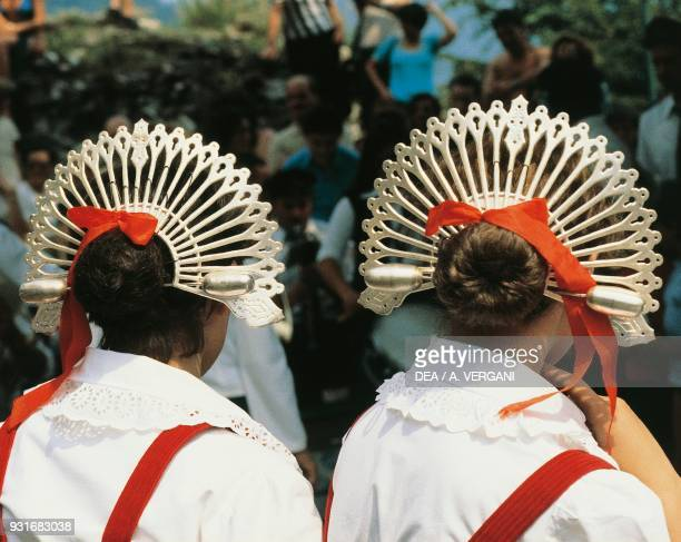 Traditional hairstyle and typical raggiera brianzola worn by women in the brianzolo folk group The Betrothed, Oggiono, Lombardy, Italy.