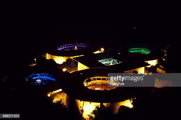 Traditional Hakka Tulou homes lit up at night in different colors in the county of Yongding, well known as the Hakka Tulou region. In 2008, UNESCO...