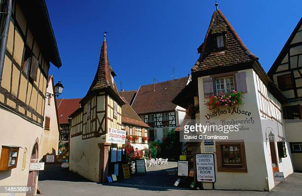 traditional half-timbered houses offering wine tastings in the haut-rhin. - haut rhin stock pictures, royalty-free photos & images