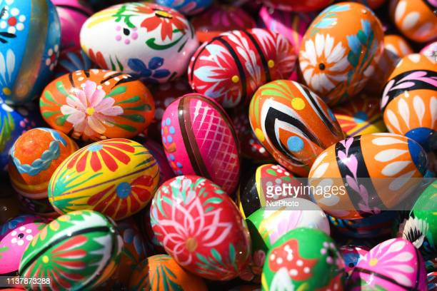 Traditional hand painted Easter eggs seen for sale in Krakow's Easter Market on Maundy Thursday the Christian holy day falling on the Thursday before...