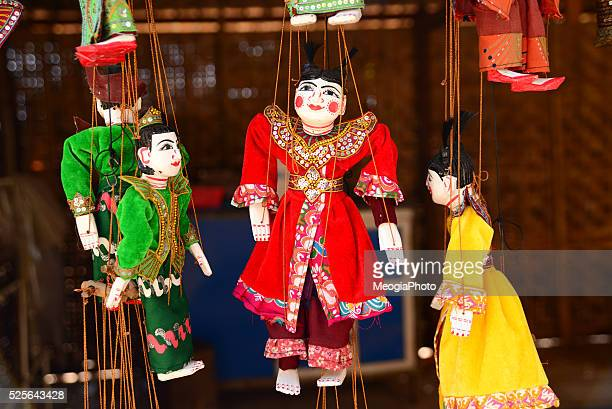 traditional handicraft puppets are sold in a shop in bagan, myanmar - dolly golden stock pictures, royalty-free photos & images
