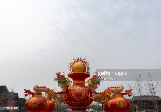 Traditional handmade Zigong lanterns with a classical theme of two dragons struggling for one pearl shown at the entrance of a city park Zigong is an...