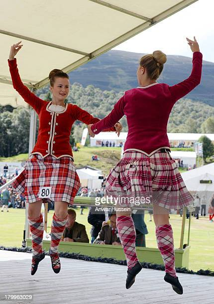 Traditional highland dancers participate in the Braemar Highland Games at The Princess Royal and Duke of Fife Memorial Park on September 7 2013 in...