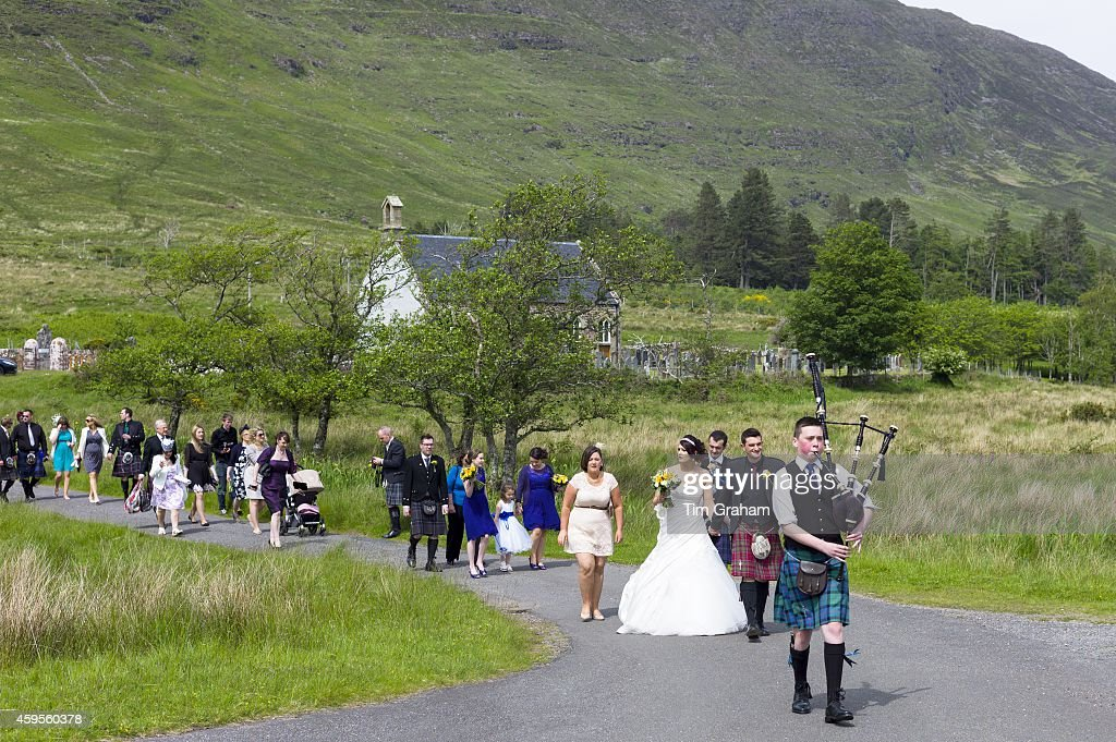 Scottish wedding procession pictures getty images traditional highland scottish wedding with piper leading procession of bride and groom and wedding guests from junglespirit Choice Image