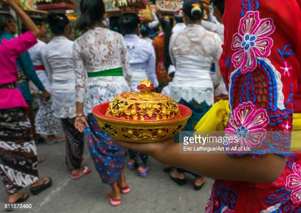 A traditional hindu temple festival procession in Tirta Empul temple Bali island Tampaksiring Indonesia on July 19 2015 in Tampaksiring Indonesia