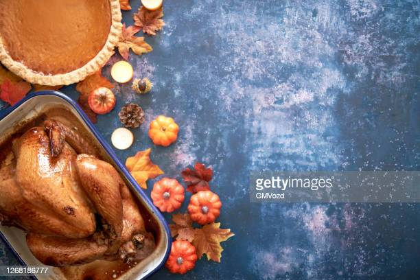 traditional holiday stuffed turkey on rustic background - thanksgiving stock pictures, royalty-free photos & images