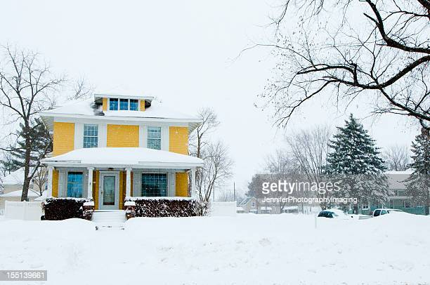 traditional home in a snow storm - winter house stock pictures, royalty-free photos & images