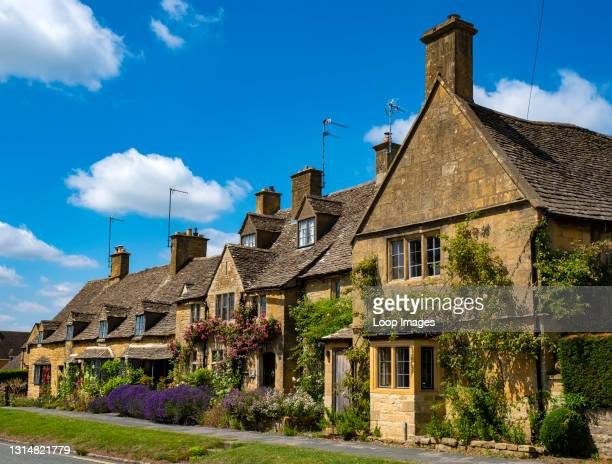 Traditional honey coloured Cotswold cottages in Broadway.