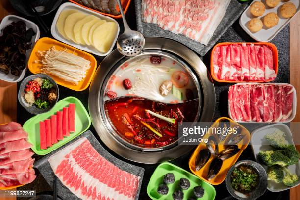 traditional hotpot soup with ingredients - sichuan province stock pictures, royalty-free photos & images