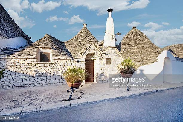 traditional house against sky - alberobello stock photos and pictures