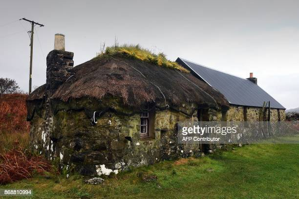A traditional house on the Isle of Ulva off Scotland's west coast on October 20 2017 When tycoons in helicopters began landing on Scotland's Isle of...