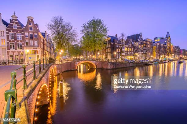 Traditional house with canal in Amsterdam