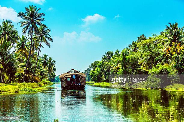 traditional houseboat on kerala backwaters - houseboat stock pictures, royalty-free photos & images