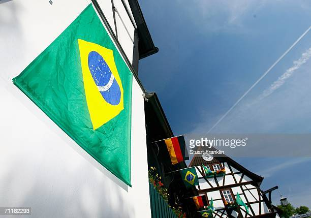 Traditional houses bear the Brazilain and German flags in the village of Falkenstein which is the base for the Brazilian National Football Team for...