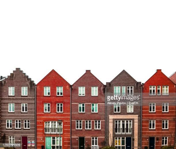 traditional houses in amsterdam - netherlands stock pictures, royalty-free photos & images