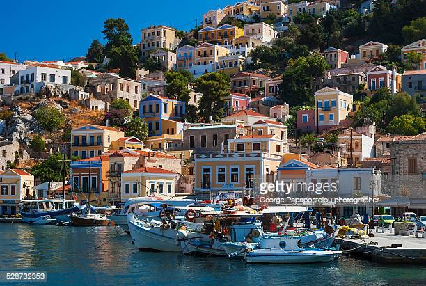 traditional houses in symi island greece - symi stock photos and pictures