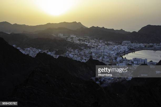 Traditional houses line the Mutrah Corniche on the harbor side in the old city district of Muscat Oman on Sunday May 6 2018 Being the Switzerland of...