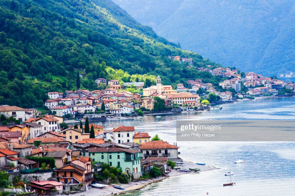 Traditional houses on waterfront of Lake Como, Lombardy, Italy : Stock Photo