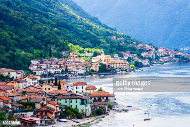 traditional houses on waterfront of lake como, lombardy, italy - lake como stock pictures, royalty-free photos & images
