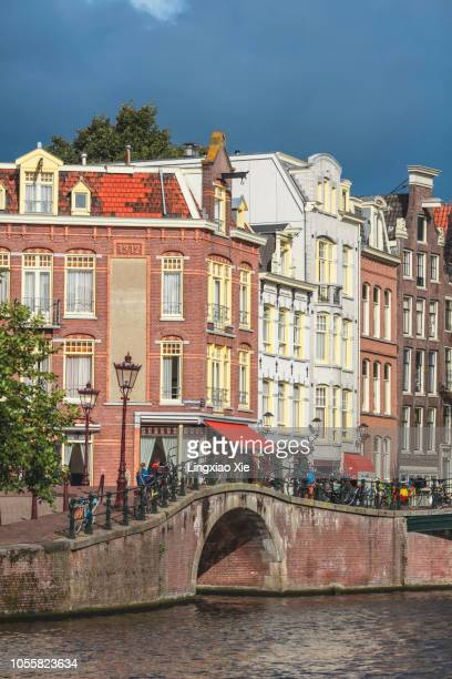 Traditional houses with bridge over Prinsengracht canal, Amsterdam, Netherlands