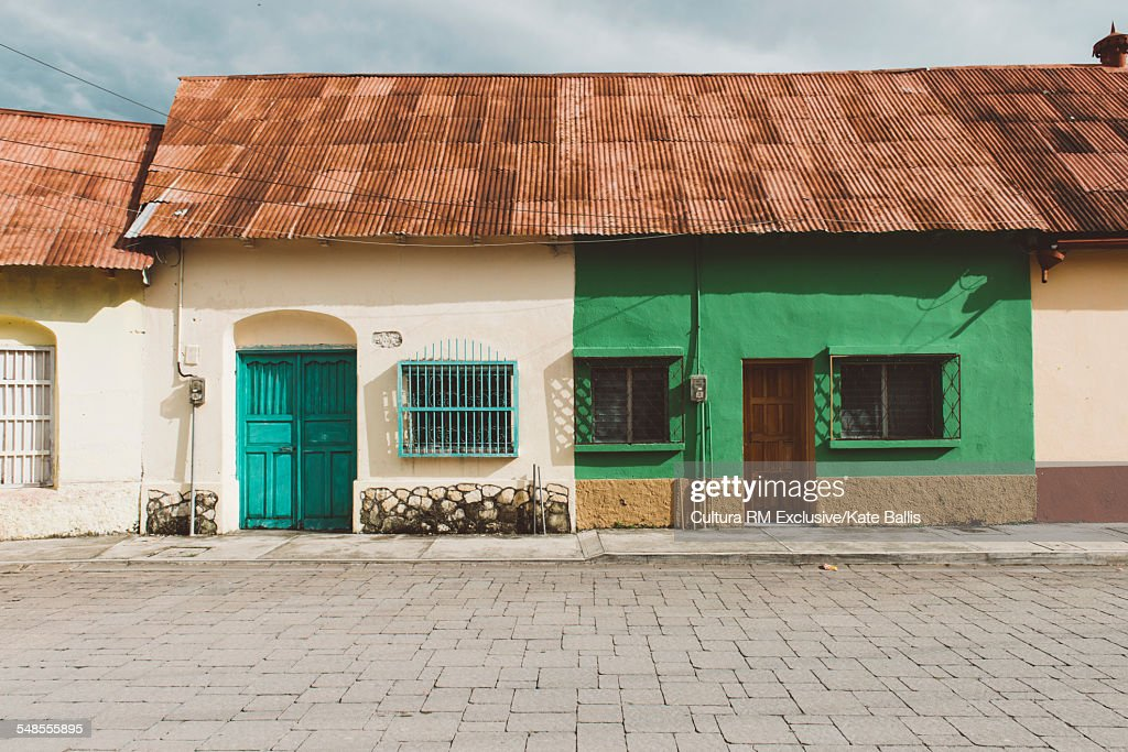 Traditional houses with corrugated roofs, Flores, Guatemala, Central America : Stock Photo